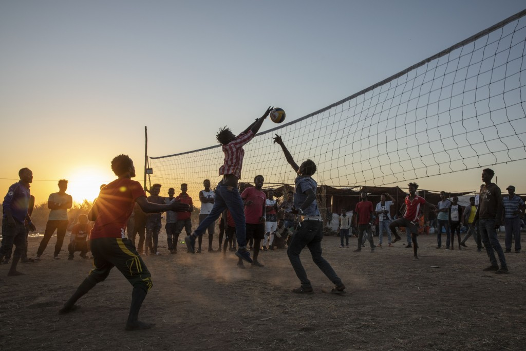 Refugees who fled the conflict in Ethiopia's Tigray region play volleyball at Um Rakuba refugee camp in Qadarif, eastern Sudan, Monday, Nov. 23, 2020....