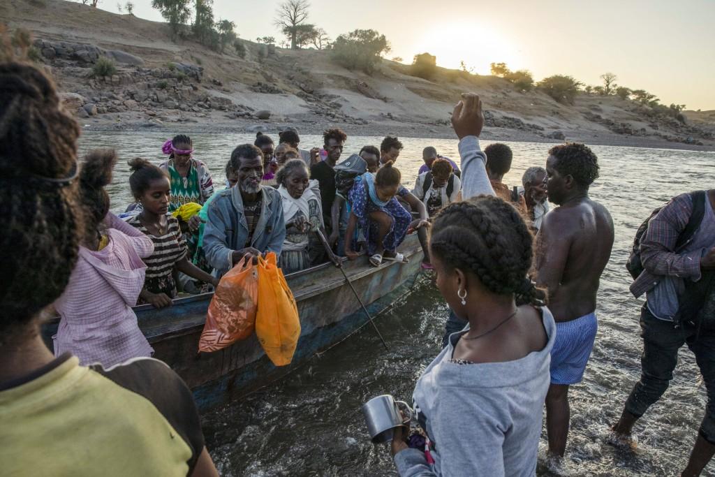 Tigrayan refugees arrive on the banks of the Tekeze River on the Sudan-Ethiopia border, in Hamdayet, eastern Sudan, Wednesday, Dec. 2, 2020. (AP Photo...