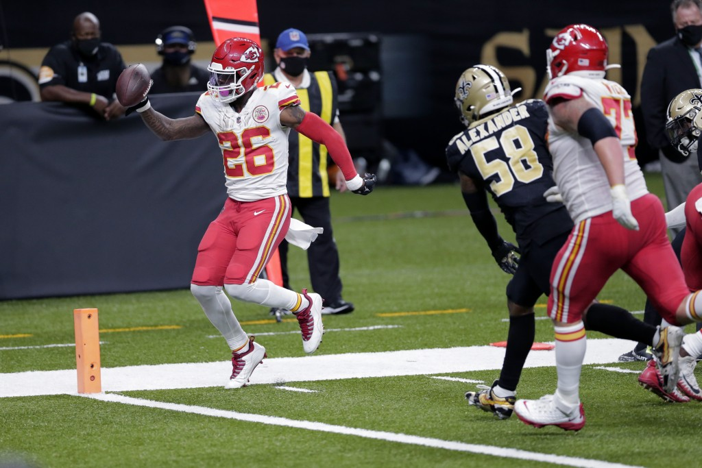 Kansas City Chiefs running back Le'Veon Bell (26) crosses the goal line past New Orleans Saints outside linebacker Kwon Alexander (58) on a touchdown ...