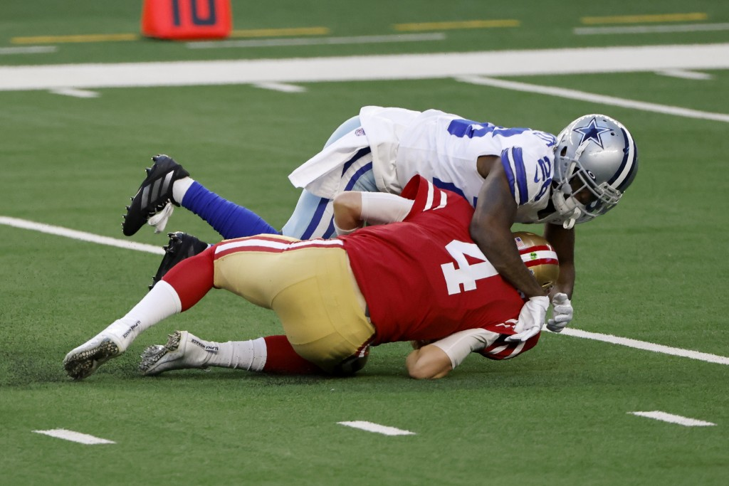 Dallas Cowboys cornerback Jourdan Lewis (26) sacks San Francisco 49ers quarterback Nick Mullens (4) in the first half of an NFL football game in Arlin...