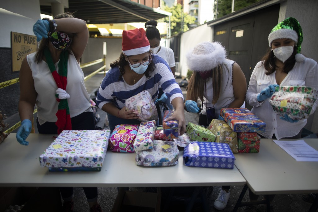 "The volunteer group Un Juguete, Una Buena Noticia,"" or One Toy, One Good News, prepare Christmas presents to give children in Caracas, Venezuela, Frid..."