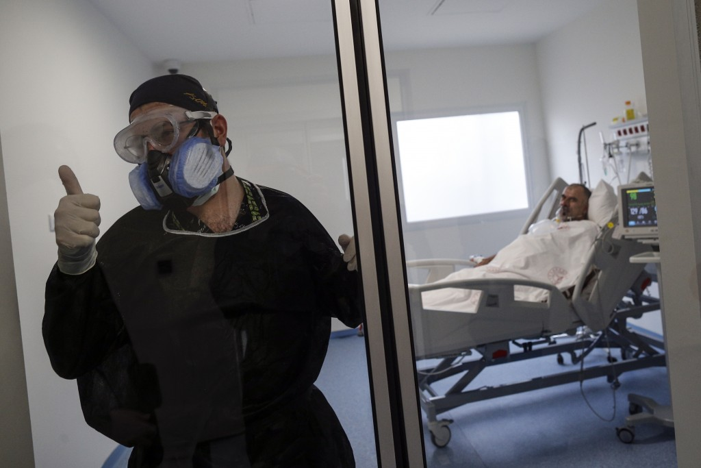 Nurse Batuhan Yagci, 23, gestures as he leaves the room of Hikmet Yucel, a 52-year-old construction worker infected with COVID-19, receiving pressuris...