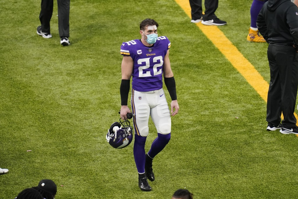 Minnesota Vikings safety Harrison Smith walks on the sideline during the second half of an NFL football game against the Chicago Bears, Sunday, Dec. 2...