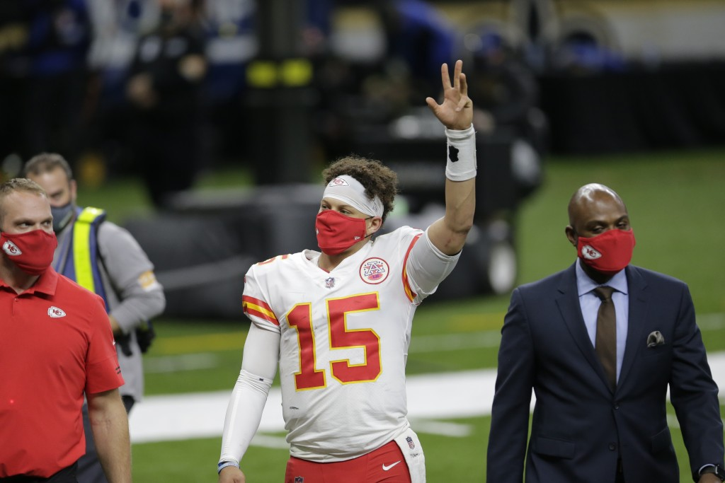 Kansas City Chiefs quarterback Patrick Mahomes (15) waves as he walks off the field after an NFL football game against the New Orleans Saints in New O...