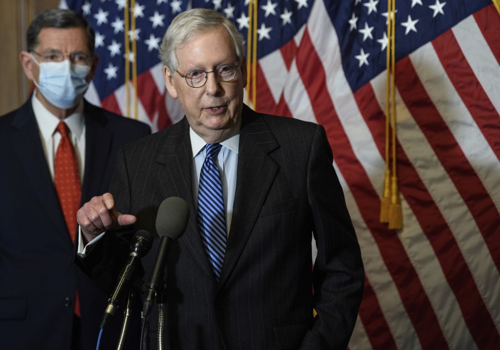 FILE - In this Tuesday, Dec. 15, 2020, file photo, Senate Majority Leader Mitch McConnell, of Kentucky, speaks during a news conference with other Sen...