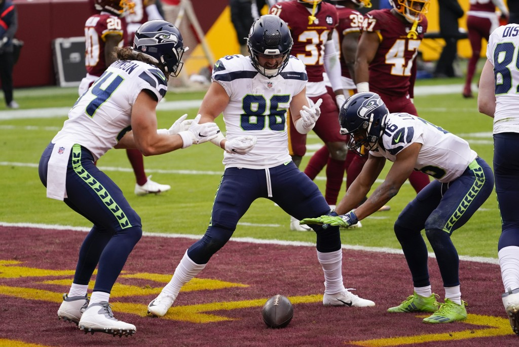 Seattle Seahawks tight end Jacob Hollister (86) celebrating his touchdown with teammates tight end Colby Parkinson (84) and wide receiver Tyler Locket...