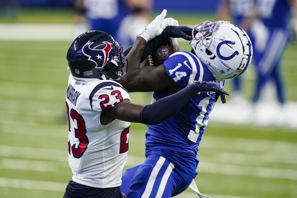 Indianapolis Colts wide receiver Zach Pascal (14) makes a catch under pressure from Houston Texans free safety Eric Murray (23) in the first half of a...