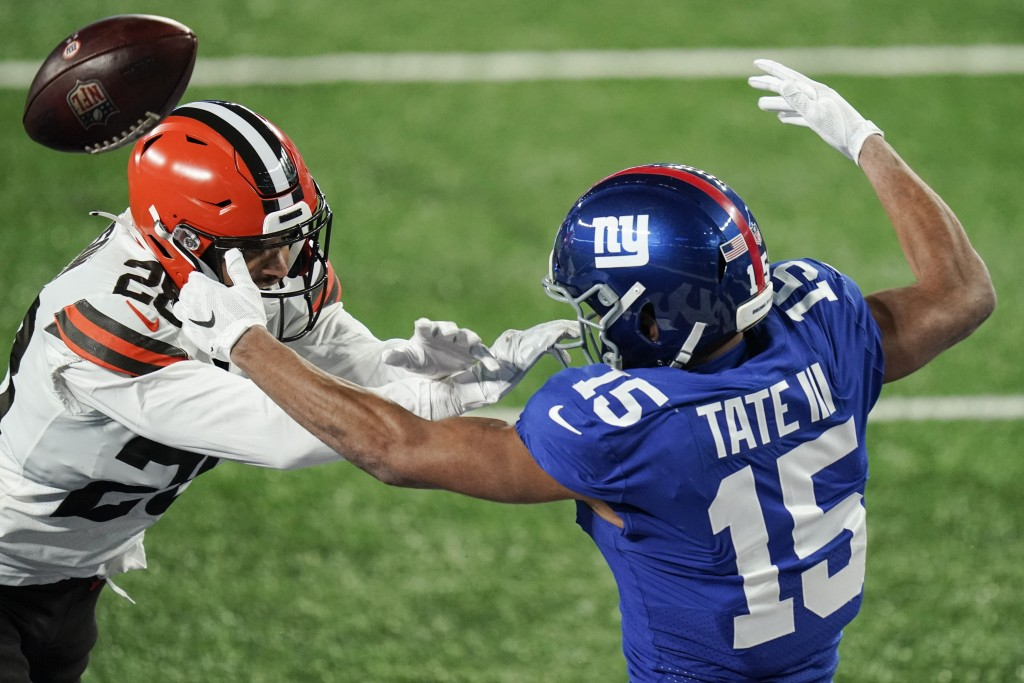 Cleveland Browns' Kevin Johnson, left, defends New York Giants' Golden Tate (15) during the second half of an NFL football game, Sunday, Dec. 20, 2020...