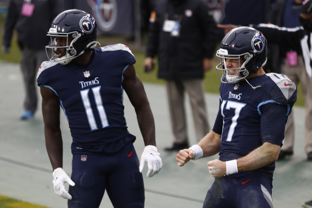 Tennessee Titans quarterback Ryan Tannehill celebrates after scoring during the first half of an NFL football game against the Detroit Lions Sunday, D...