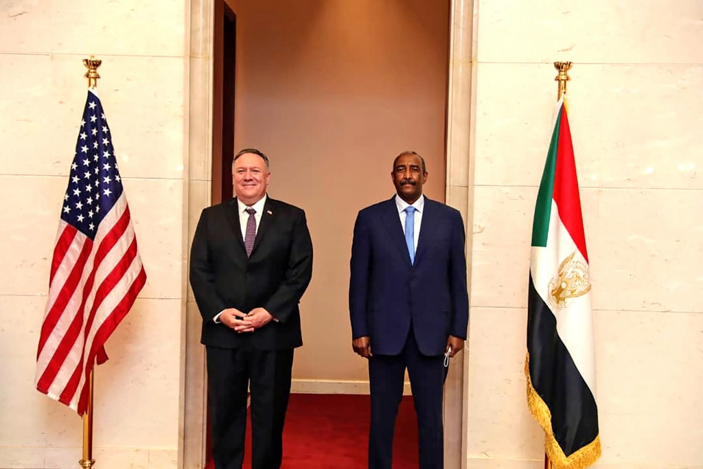 FILE - In this Aug. 25, 2020 file photo, U.S. Secretary of State Mike Pompeo stands with Sudanese Gen. Abdel-Fattah Burhan, the head of the ruling sov...