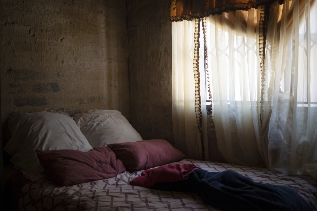 The bed that Amanda Zitho shared with her 5-year-old son Wandi is seen in their house in Orange Farm, South Africa, on Aug. 26, 2020. The boy was murd...