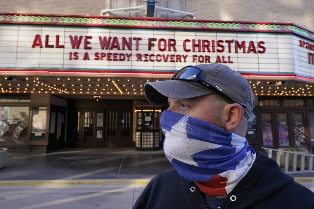 Employee Grayson Allred poses for a photo after putting up a message on the front marquee at the Paramount Theatre on Wednesday, Dec. 16, 2020, in Abi...