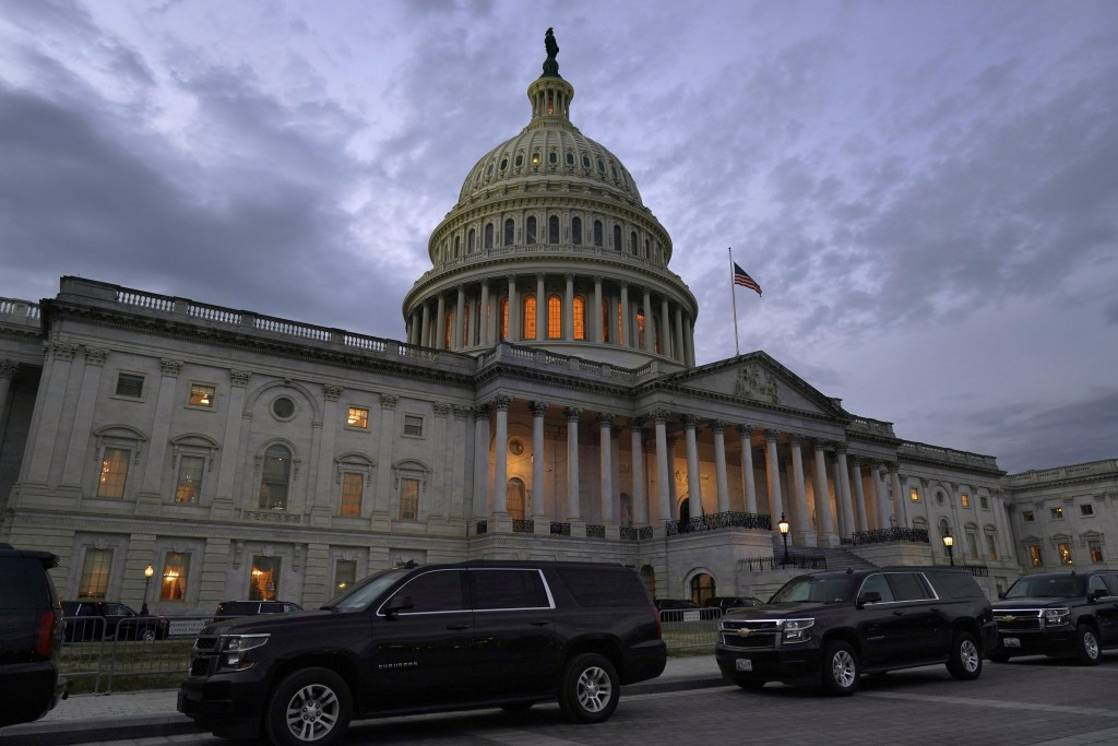 Dusk falls over the Capitol, Monday, Dec. 21, 2020, in Washington. Congressional leaders have hashed out a massive, year-end catchall bill that combin...