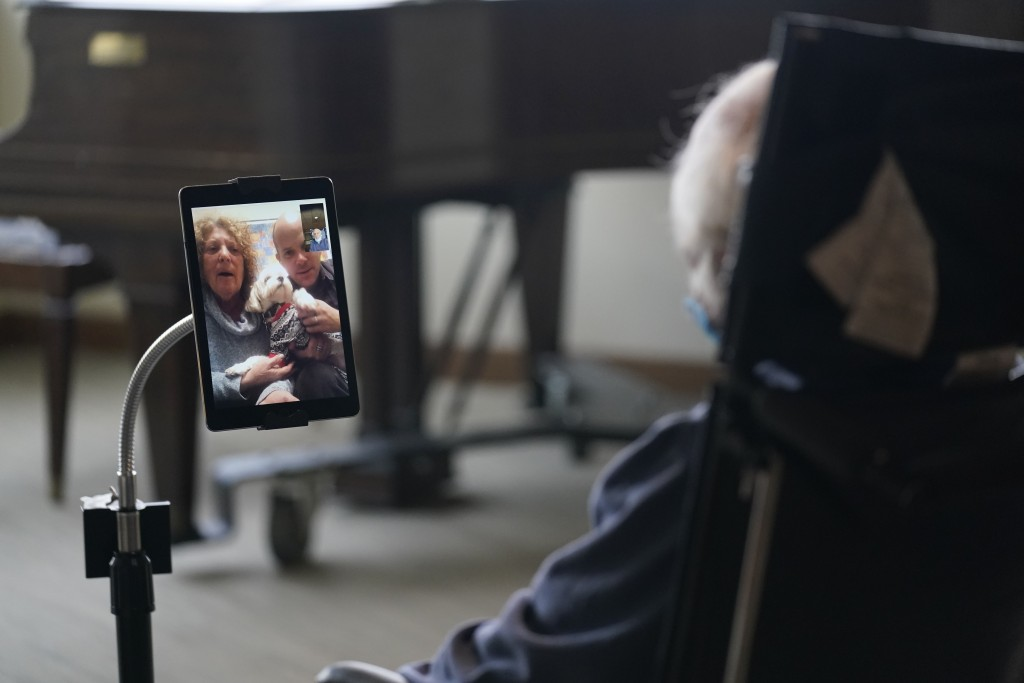 Jerry Woloz, 79, visits with his family and a new dog via a tablet at The Hebrew Home at Riverdale in New York, Wednesday, Dec. 9, 2020. Video and dri...