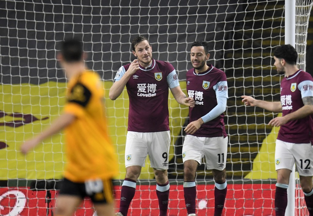 Burnley's Chris Wood, centre, celebrates with teammates after scoring his side's second goal during the English Premier League soccer match between Bu...