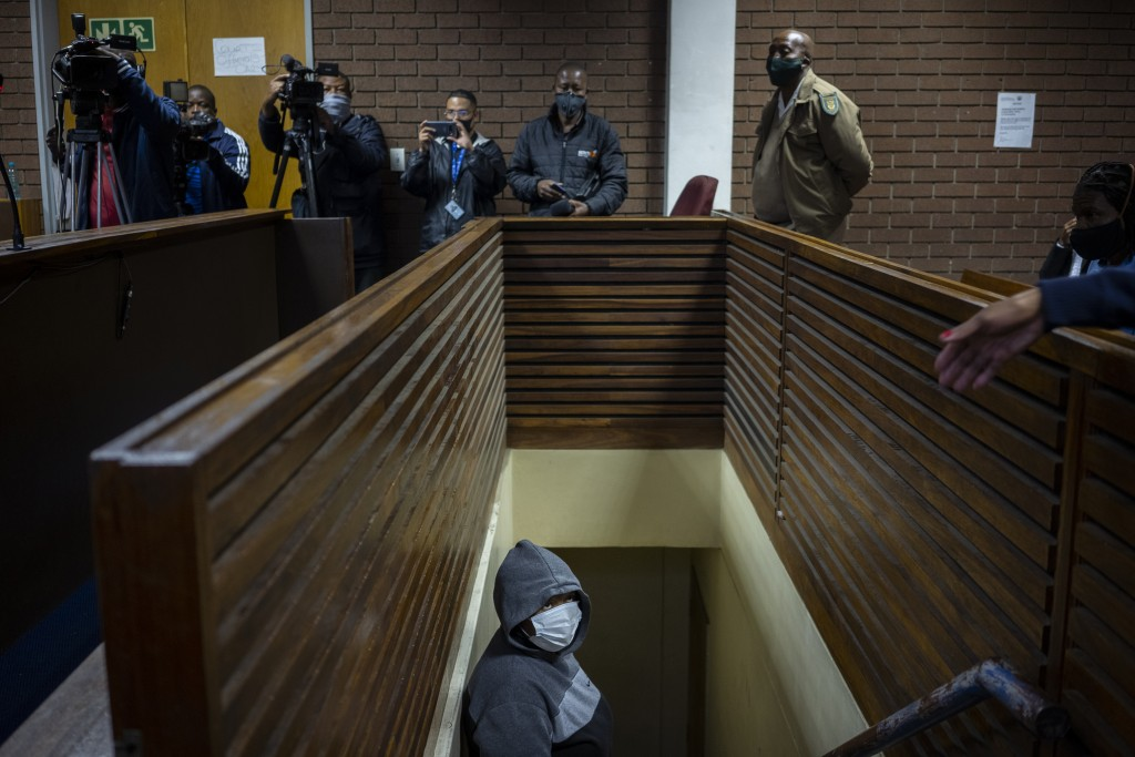 The suspect charged with killing Wandi Zitho waits to enter the courtroom in Vereeniging, South Africa, on Oct. 12, 2020. She was released and the cas...