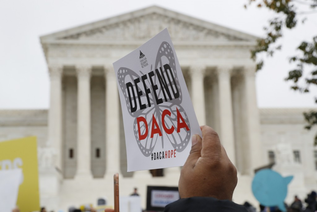 FILE - In this Nov. 12, 2019, file photo people rally outside the Supreme Court over President Trump's decision to end the Deferred Action for Childho...