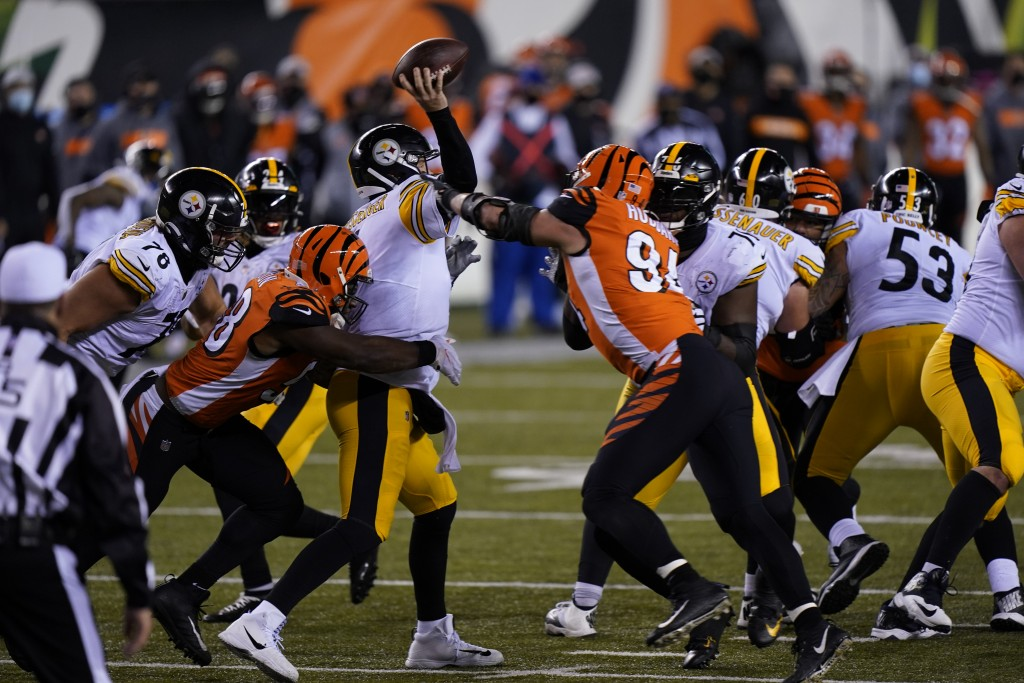 Pittsburgh Steelers quarterback Ben Roethlisberger (7) is hit as he throws during the second half of an NFL football game against the Cincinnati Benga...