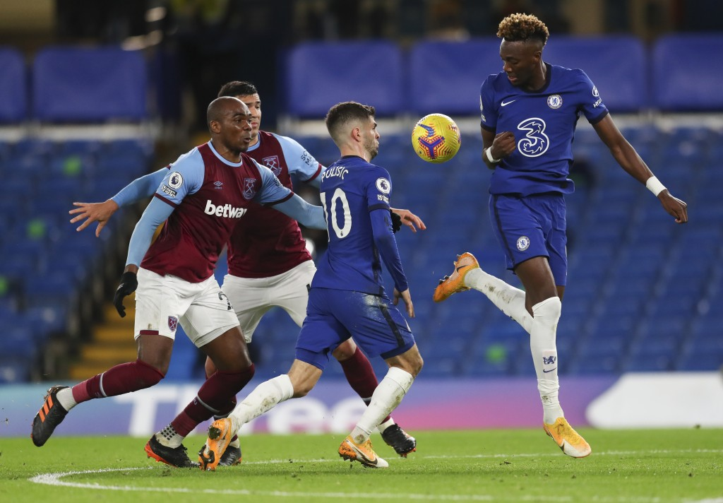 Chelsea's Tammy Abraham, right, plays at the bay as teammate Christian Pulisic watches during the English Premier League soccer match between Chelsea ...
