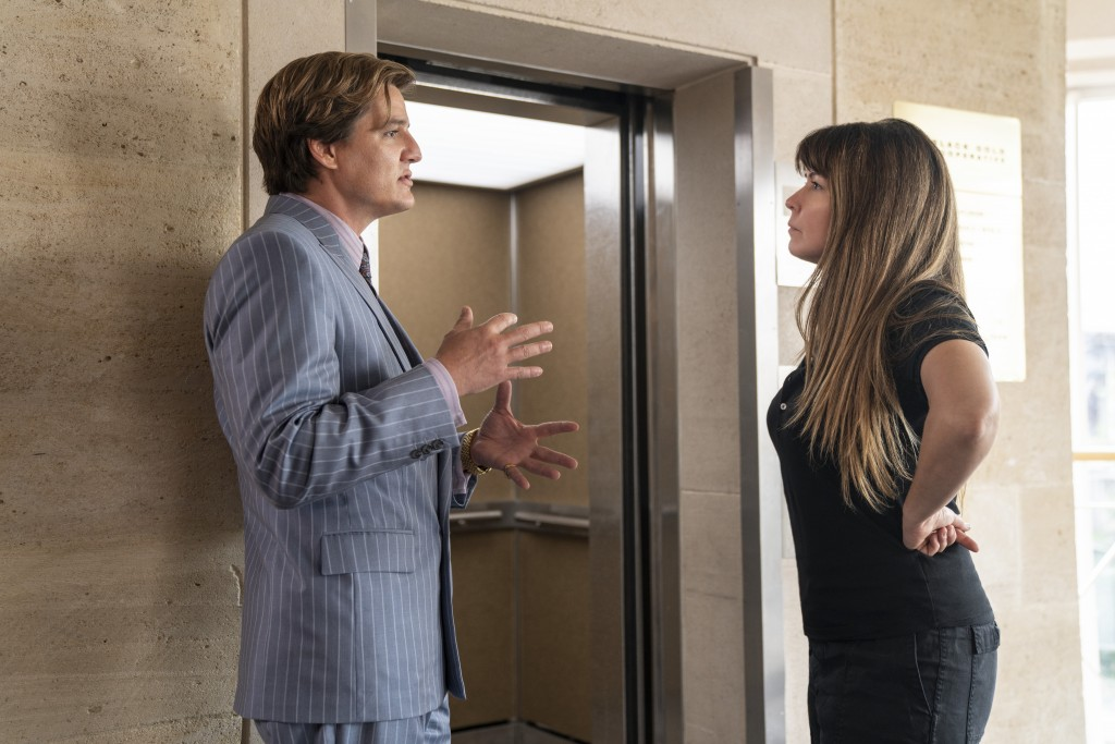 """This image released by Warner Bros. Entertainment shows Pedro Pascal, left, with director Patty Jenkins in a scene from """"Wonder Woman 1984."""" (Clay Eno..."""