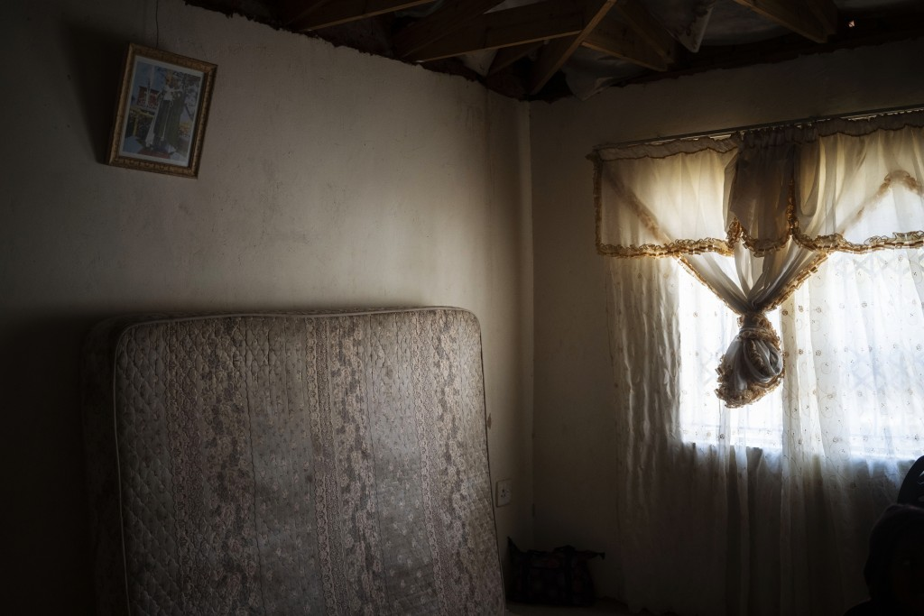 The mattress on which 12-year-old Onthatile Mohapi once slept leans against the wall of his bedroom in Damonsville, South Africa, on June 8, 2020. Moh...