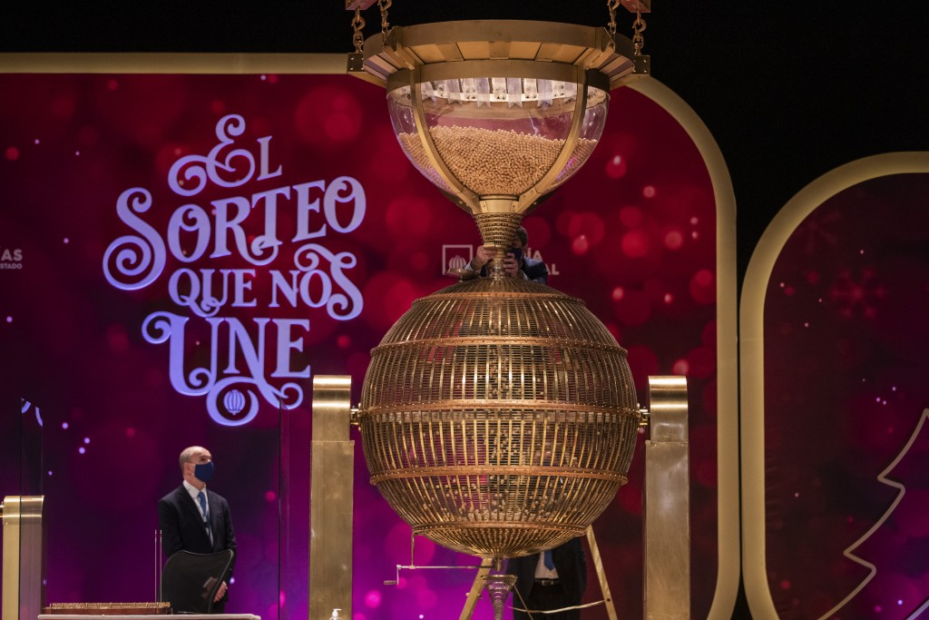 A worker prepares the numbered lottery balls at Madrid's Teatro Real opera house during Spain's bumper Christmas lottery draw known as El Gordo, or Th...