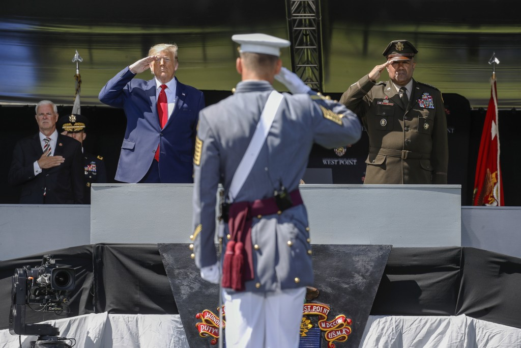FILE - In this June 13, 2020 photo, President Donald Trump, left, and the United States Military Academy superintendent Darryl A. Williams, right, sal...