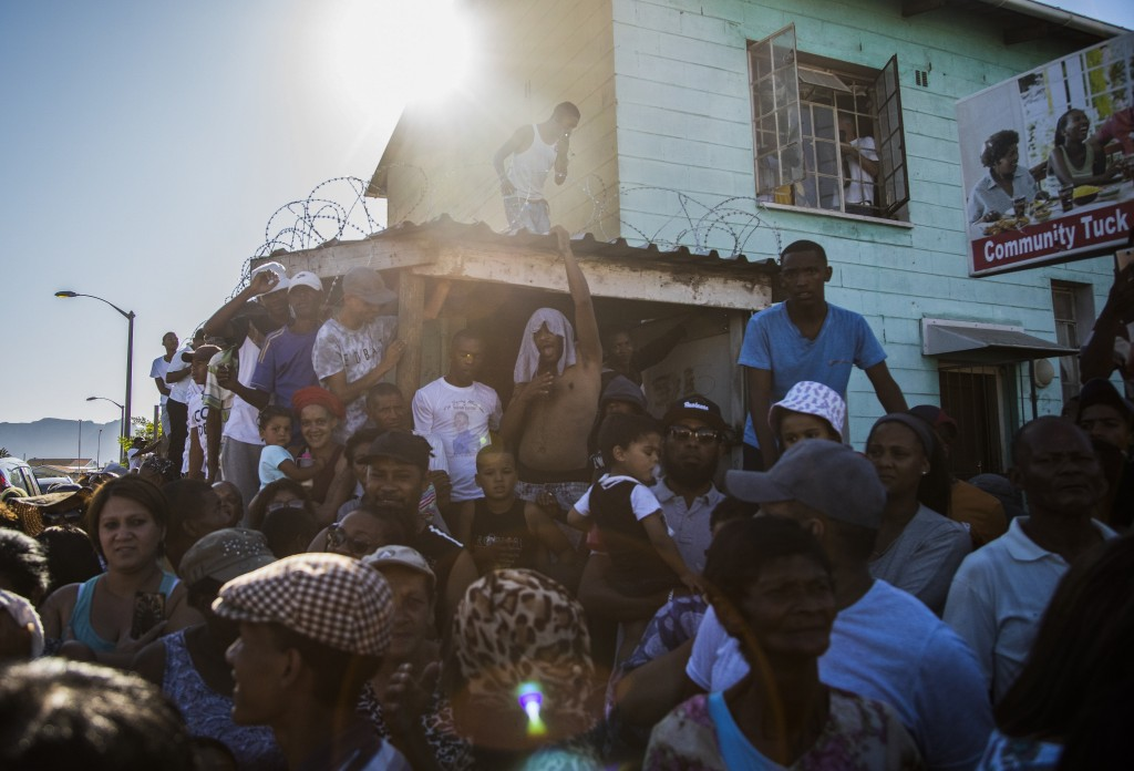 Community members call for the death penalty outside the house of 8-year-old Tazne Van Wyk, who was raped and murdered, in Cape Town, South Africa, Fe...