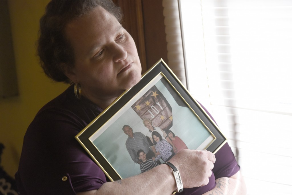 Christina Grim holds a family photograph that includes her mother, Verl Grim, top right, on Saturday, Dec. 19, 2020, at her home in Littlestown, Pa. G...