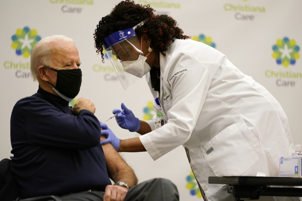 President-elect Joe Biden receives his first dose of the coronavirus vaccine at ChristianaCare Christiana Hospital in Newark, Del., Monday, Dec. 21, 2...