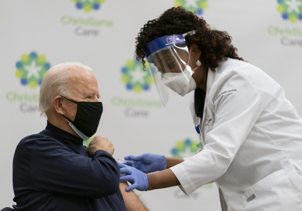 President-elect Joe Biden receives his first dose of the coronavirus vaccine from Nurse partitioner Tabe Mase at Christiana Hospital on live televisio...