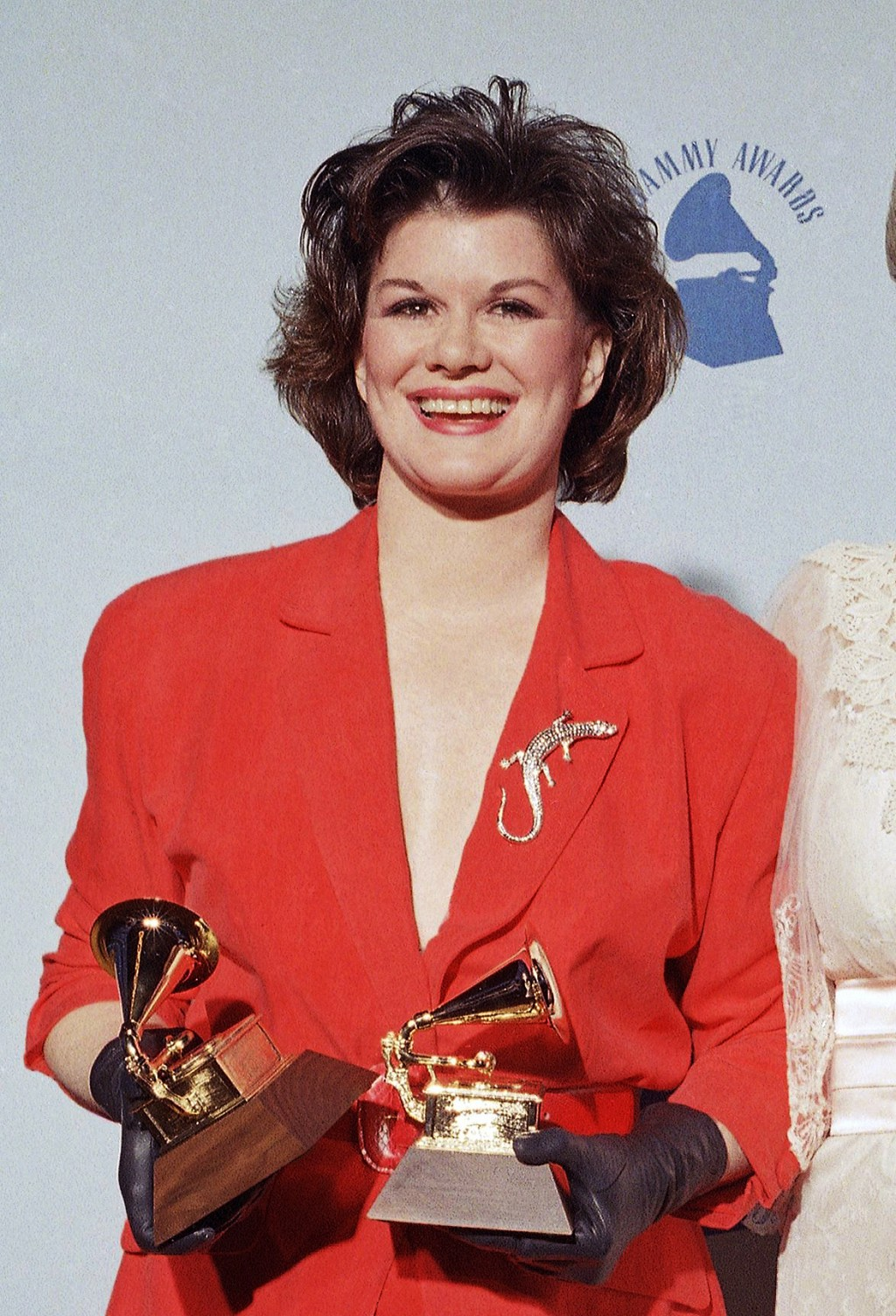 """FILE -  K.T. Oslin holds her awards for best female country vocal performance and best country song for """"Hold Me"""" at the  31st Annual Grammy Awards in..."""