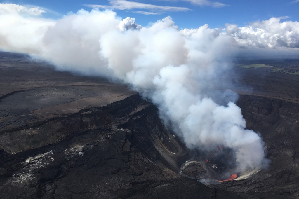 A plume rises near active fissures in the crater of Hawaii's Kilauea volcano on Monday, Dec. 21, 2020. People are lining up to try to get a look at th...