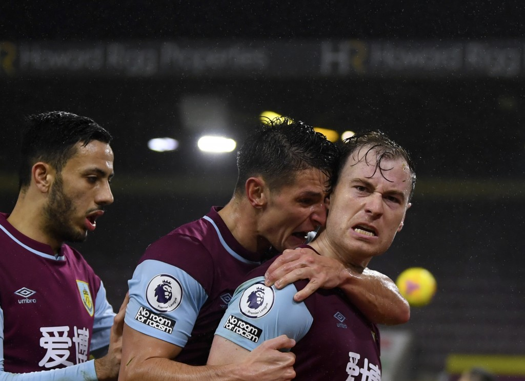 Burnley's Ashley Barnes, right, celebrates with teammates after scoring his side's opening goal during the English Premier League soccer match between...