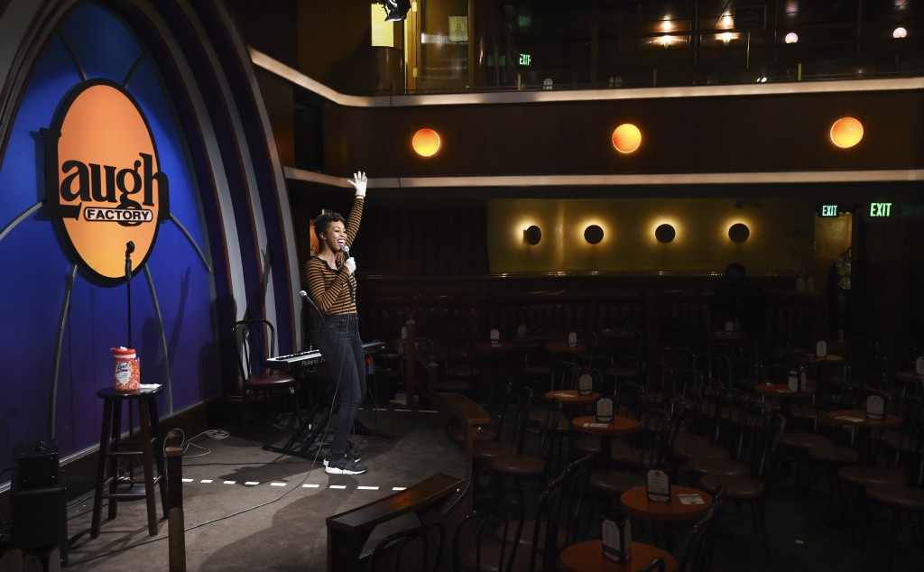 """Comedian Daphnique Springs performs to an empty room during a """"Laughter is Healing"""" stand-up comedy livestream event at the Laugh Factory comedy club,..."""