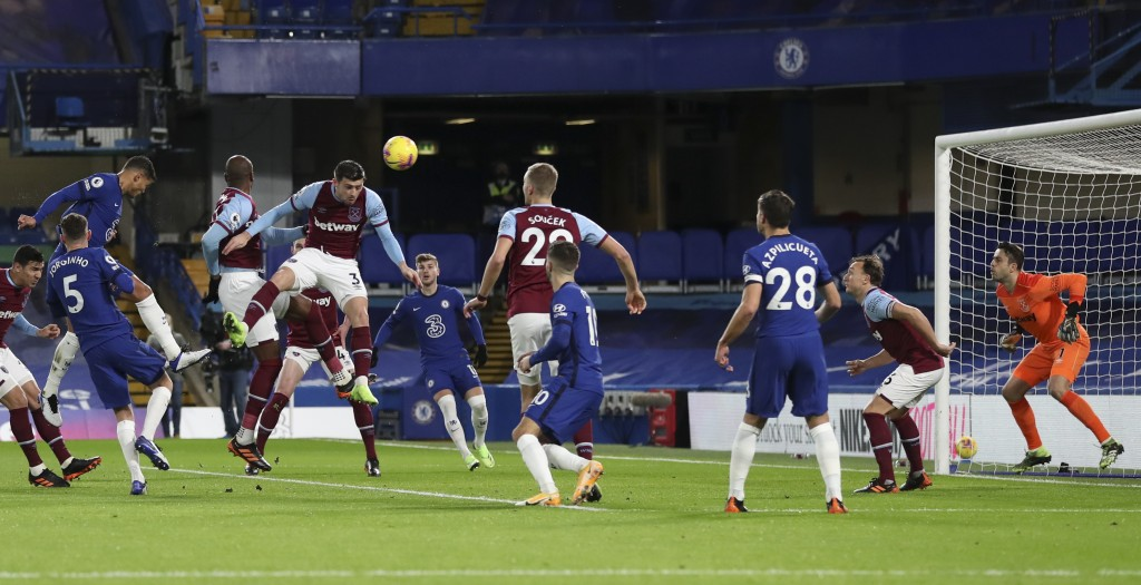 Chelsea's Thiago Silva, top left, scores his team's first goal during the English Premier League soccer match between Chelsea and West Ham at Stamford...