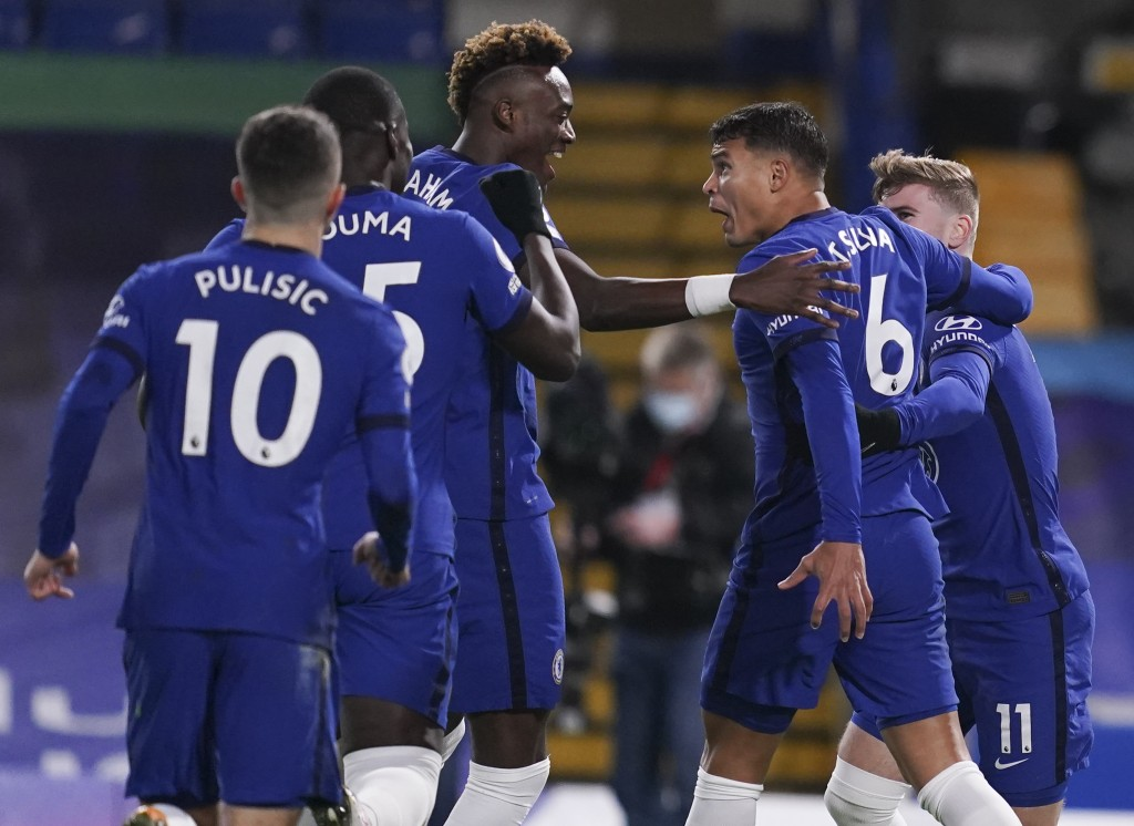 Chelsea's Thiago Silva, second right, is congratulated by teammates after scoring his team's first goal during the English Premier League soccer match...