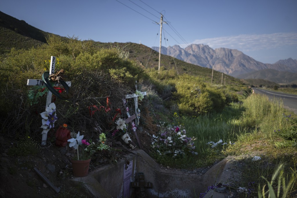 Flowers and crosses mark the place where the body of 8-year-old Tazne van Wyk was found in February next to a highway in Worcester, South Africa, more...