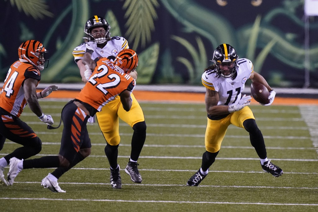 Pittsburgh Steelers' Chase Claypool (11) runs after a reception during the second half of an NFL football game against the Cincinnati Bengals, Monday,...