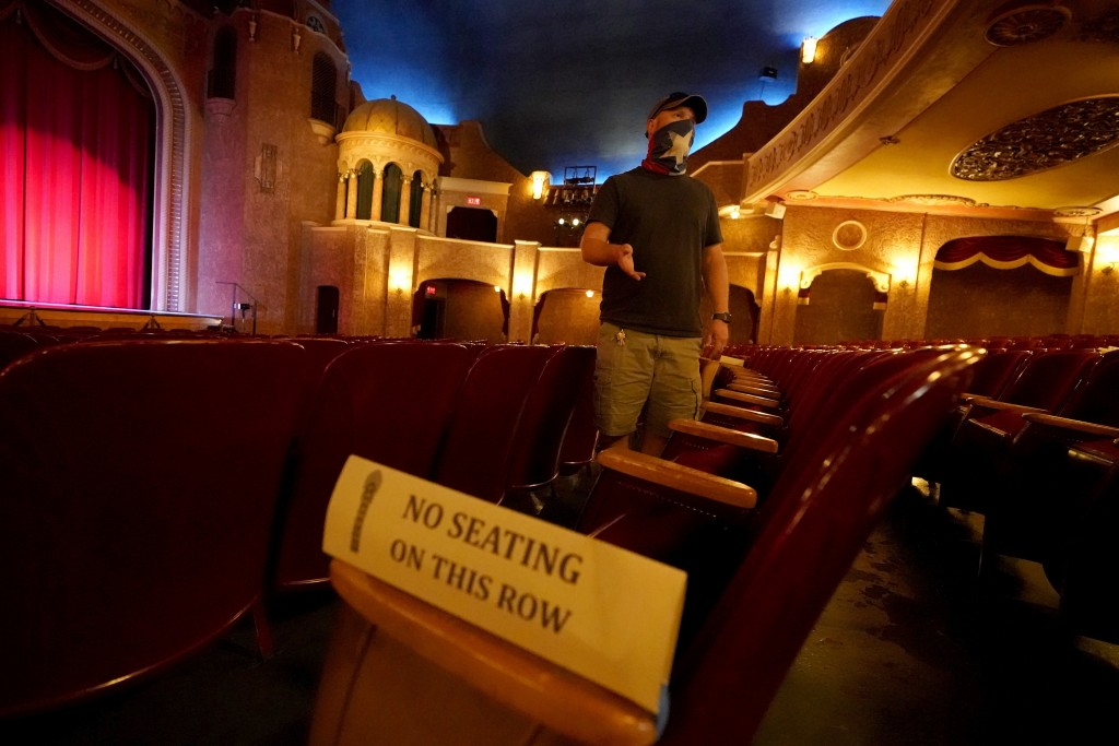 Employee Grayson Allred responds to questions from a reporter while standing inside the Paramount Theatre on Wednesday, Dec. 16, 2020, in Abilene, Tex...