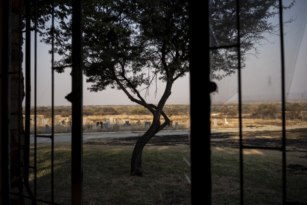 The cemetery where where the body of 12-year-old Onthatile Mohapi is buried in Damonsville, South Africa, is seen in this June 8, 2020 photo. Mohapi's...