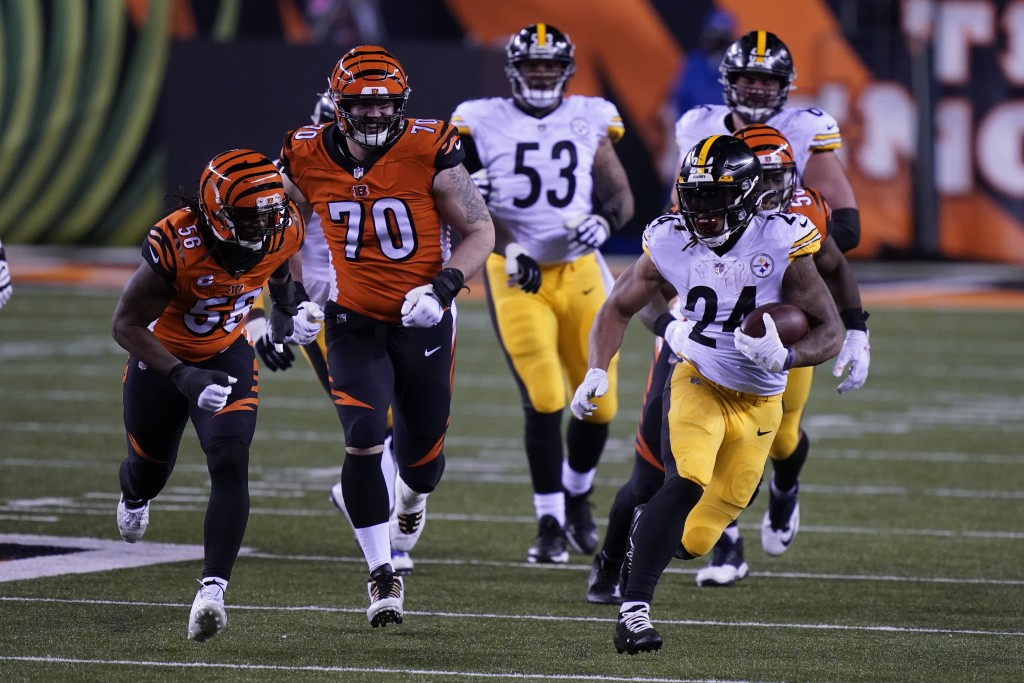 Pittsburgh Steelers' Benny Snell (24) is chased by Cincinnati Bengals' Carl Lawson (58) during the second half of an NFL football game, Monday, Dec. 2...