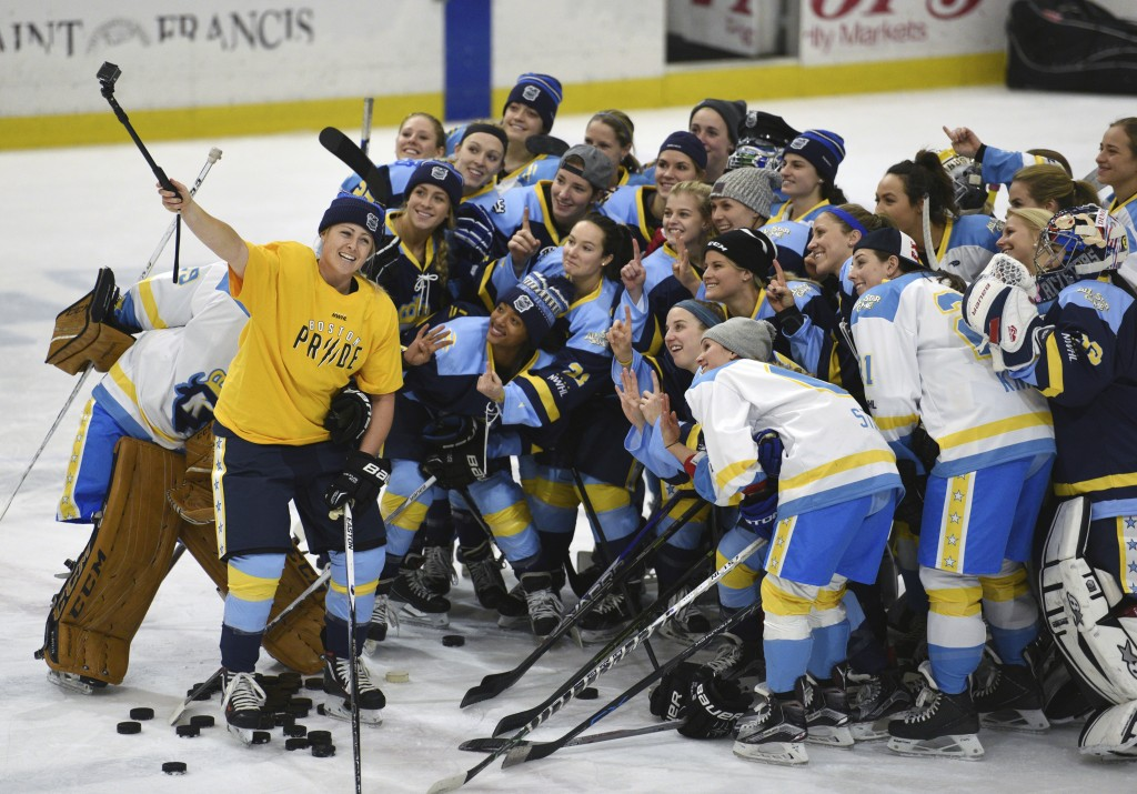 FILE - In this Jan. 24, 2016, photo, National Women's Hockey League All-Star players take time for a photo before an All-Star game at Harborcenter in ...