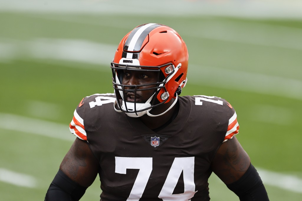 FILE - In this Oct. 11, 2020, file photo, Cleveland Browns offensive tackle Chris Hubbard (74) warms up before an NFL football game against the Indian...