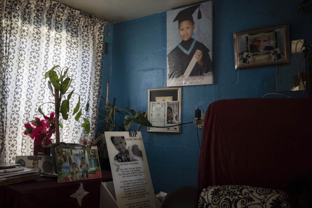 Photos of 8-year-old Tazne van Wyk hang inside her parents' house in Cape Town, South Africa, on Sept. 10, 2020. The girl's body was found in February...