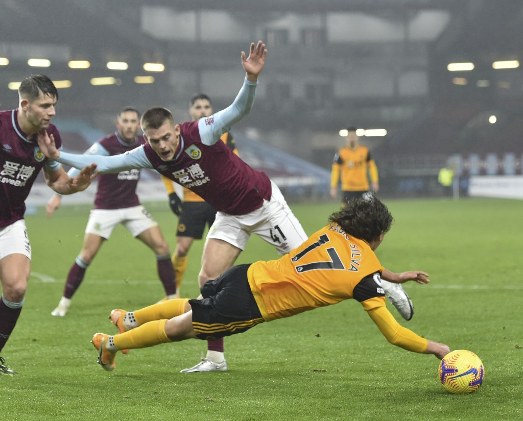 Wolverhampton Wanderers' Fabio Silva, front, duels for the ball with Burnley's Josh Benson during the English Premier League soccer match between Burn...