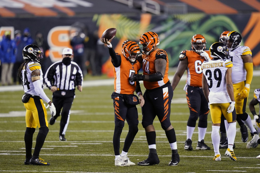 Cincinnati Bengals quarterback Ryan Finley (5) reacts with offensive guard Fred Johnson (74) after Finley rushed for a first down during the second ha...