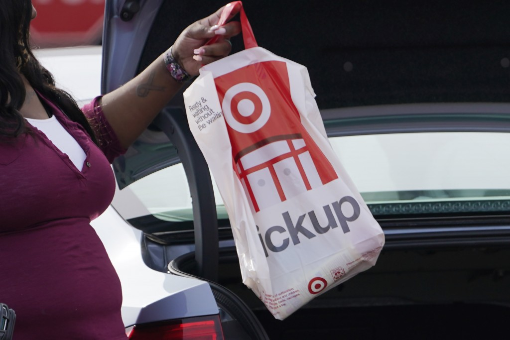 A Target employee places a curbside pickup purchase into the trunk of a customer in Jackson, Miss., Thursday, Nov. 5, 2020.  After a weak start to the...