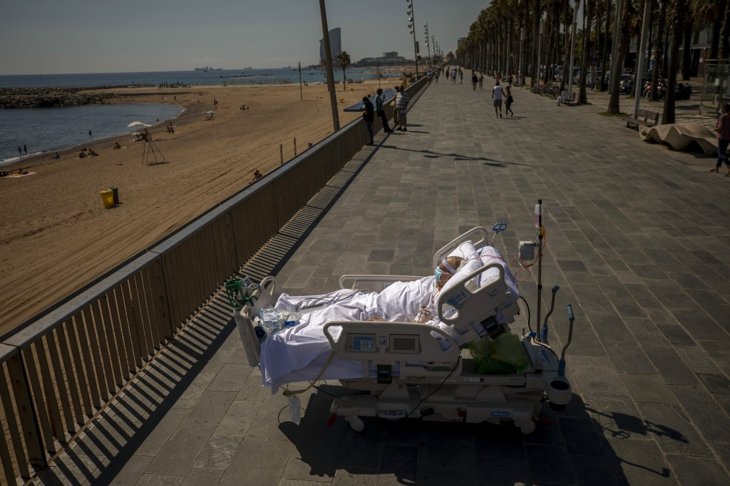 "Francisco Espana, 60, looks at the Mediterranean sea from a promenade next to the ""Hospital del Mar"" in Barcelona, Spain, Friday, Sept. 4, 2020. Franc..."