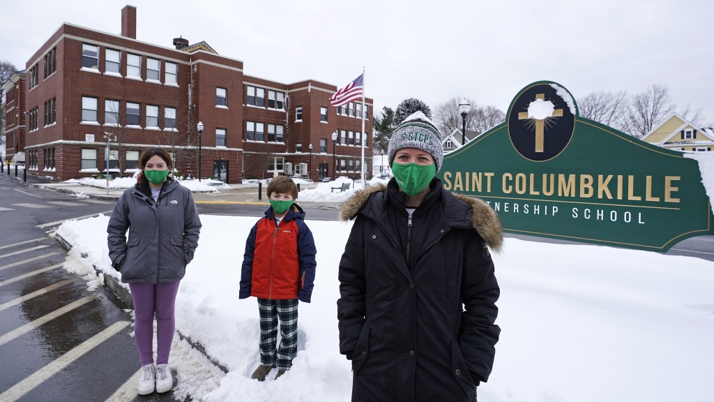 Head of School Jennifer Kowieski, right, poses with students Madeline Perry, of Brookline, Mass., left, and Landon Freytag, of Newton, Mass., center, ...
